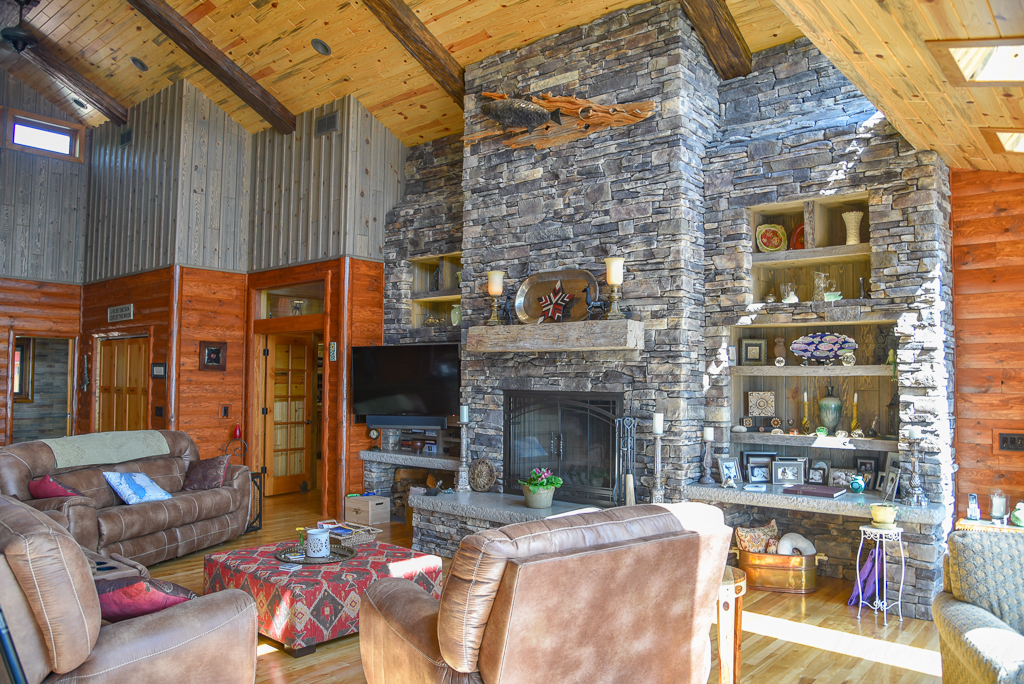 Living Room w/Barnwood, Blue Stained Paneling and Quarter Log Siding